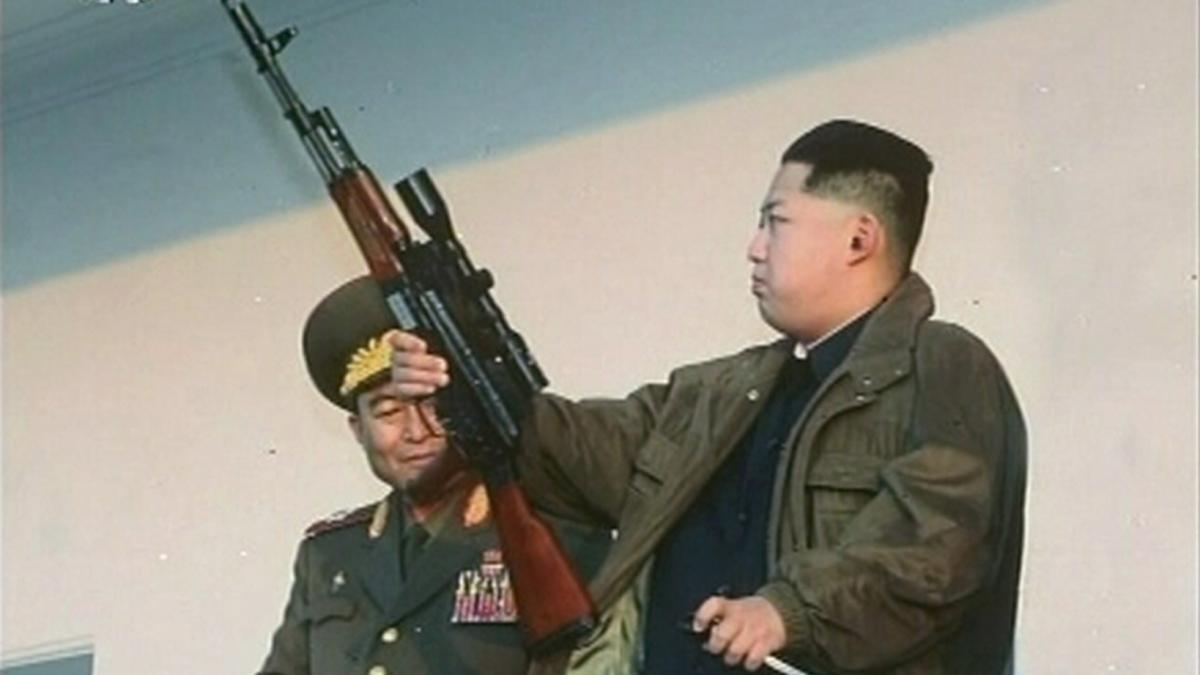 File-photo-of-North-Korea-leader-Kim-Jong-un-holding-a-weapon-in-North-Korea.jpg